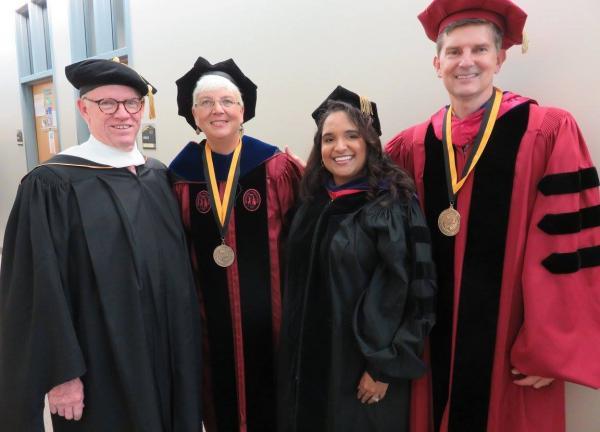 Faculty in regalia for graduation