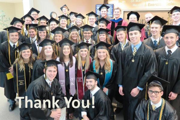 """""""Thank You!"""" superimposed over a photo of a group of graduates"""
